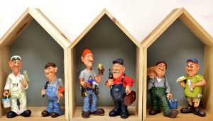 These cartoon figurines represent individuals who might use an electric stacker truck.